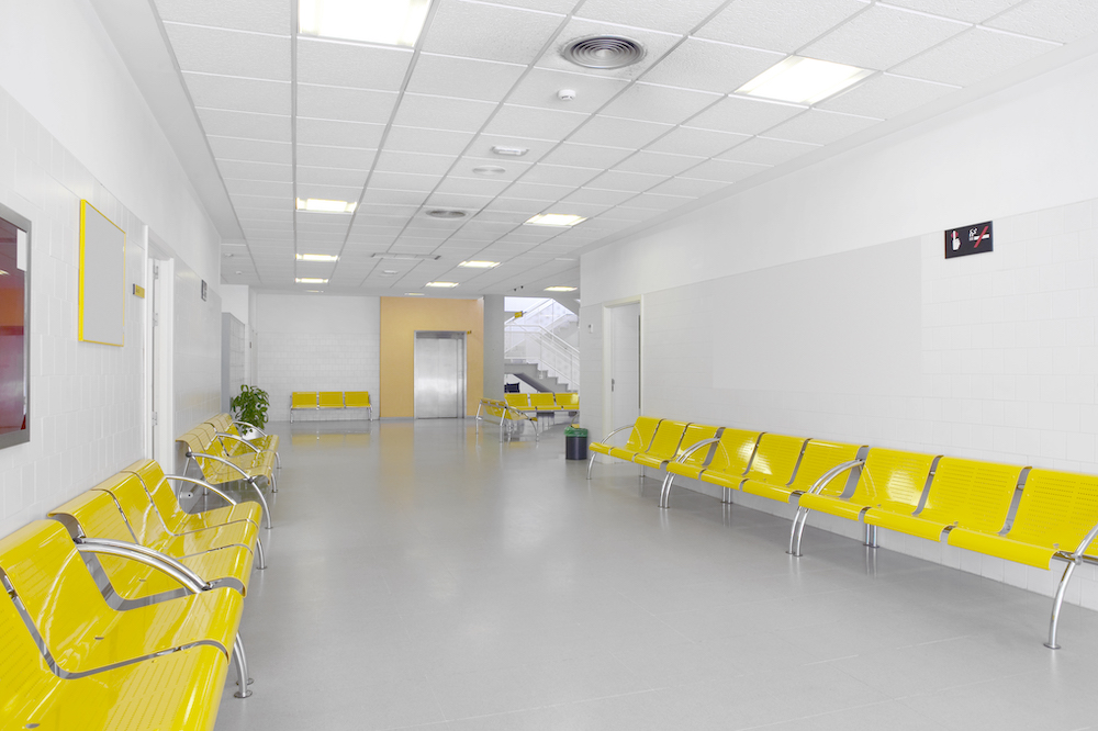 hospital building interior with yellow seats